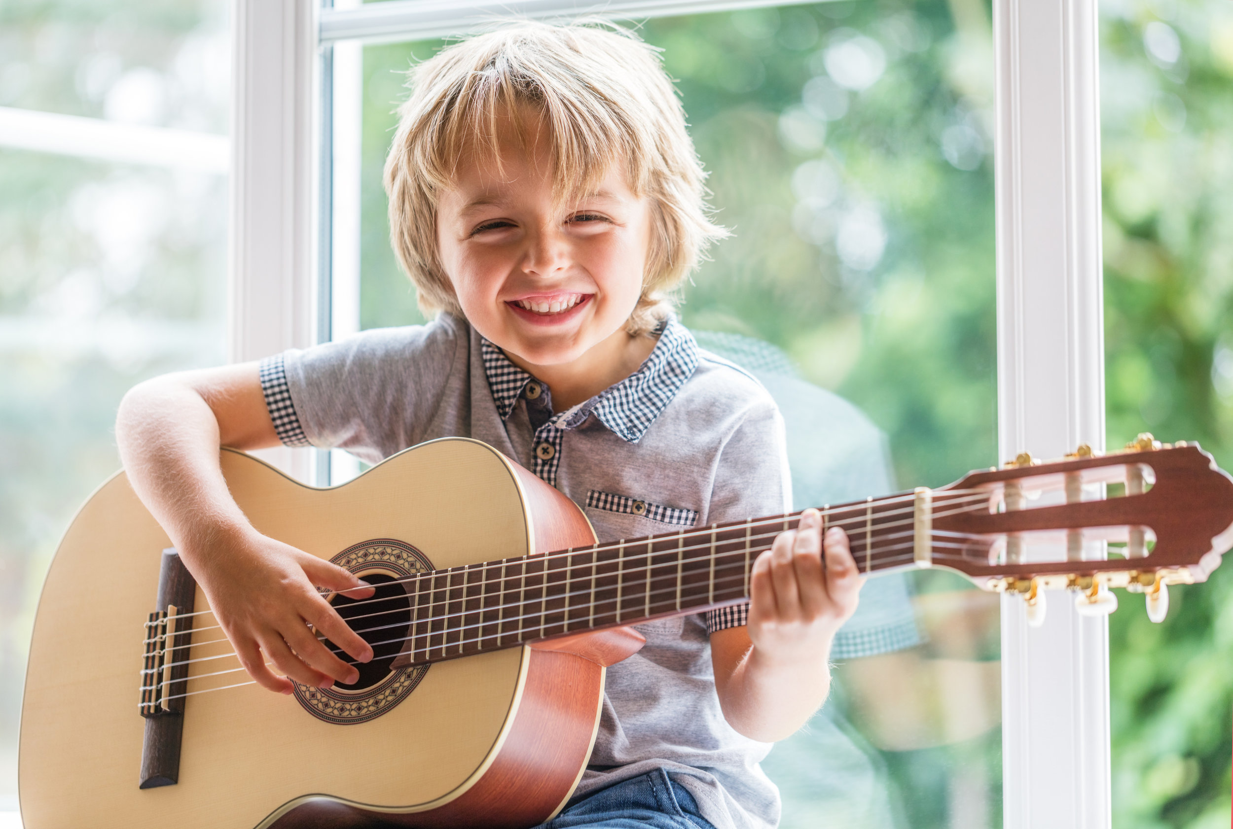 cms istock young blonde boy with guitar.jpg