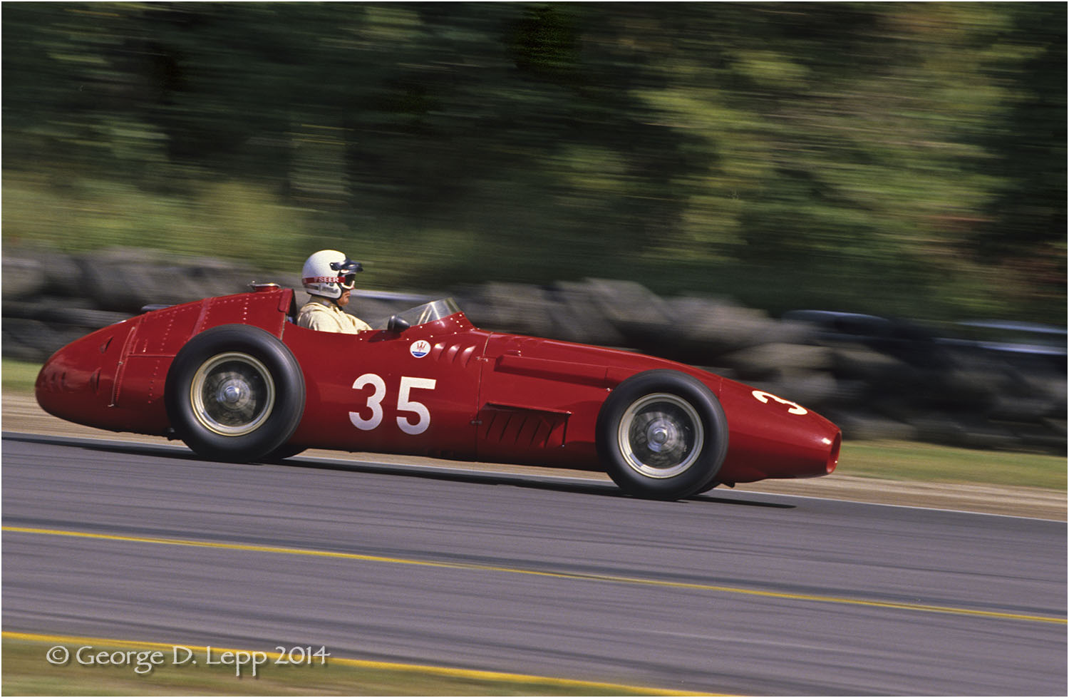 Sterling Moss in a Maserati F1, Vintage Racing, Limerock, CT. © George D. Lepp 2014  T-RA-VI-0005
