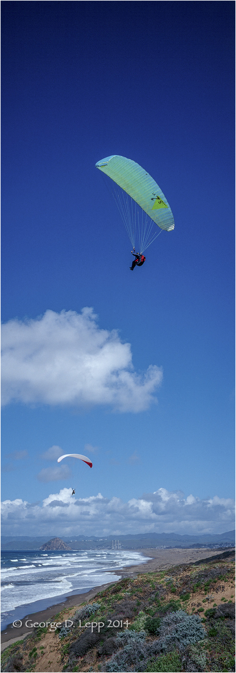 Paraglider along coastline at Montana de Morro, CA. © George D. Lepp 2014 VA-PA-0004