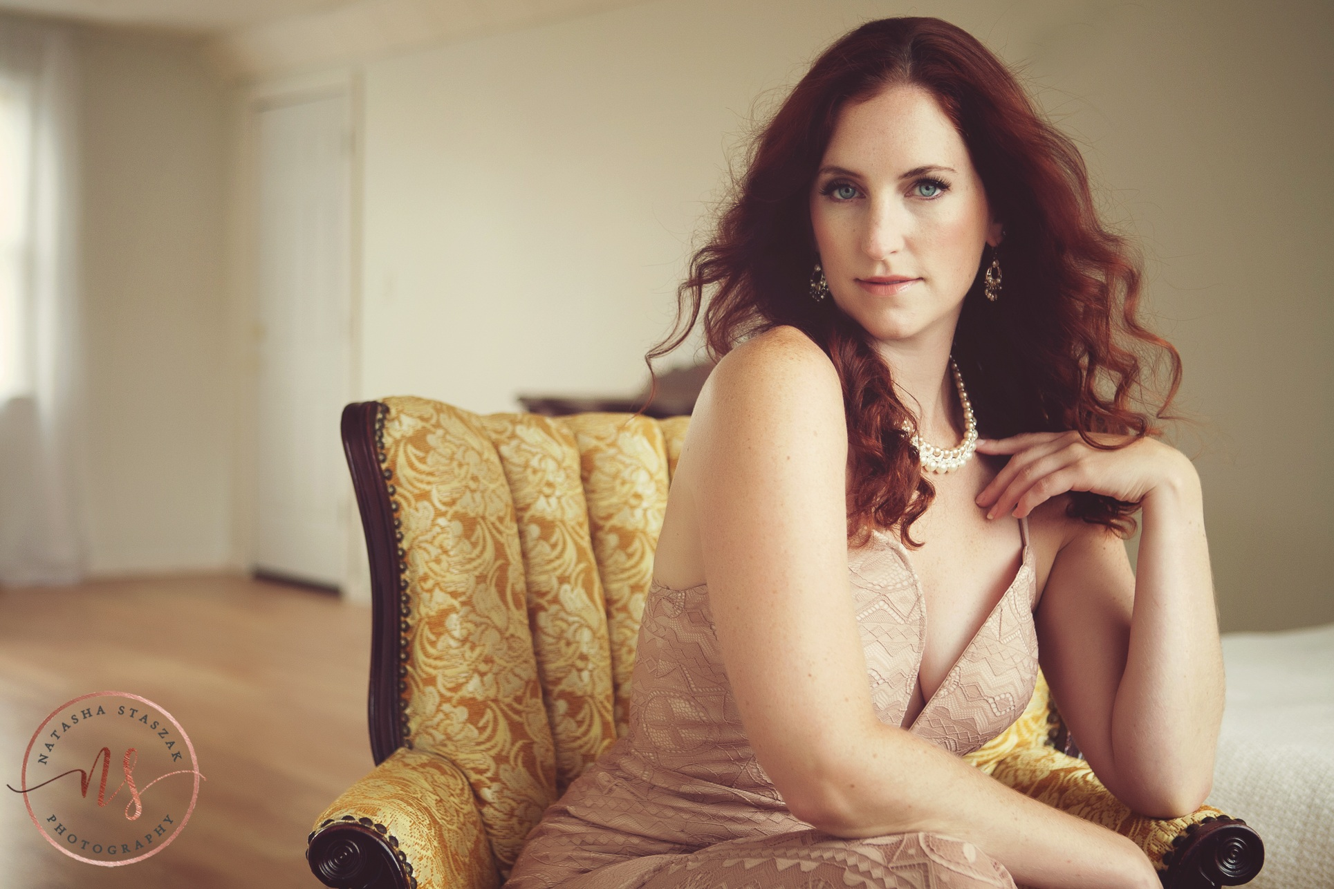 Beautiful portrait Cortney Chyme red hair and gold chair in Buffalo NY