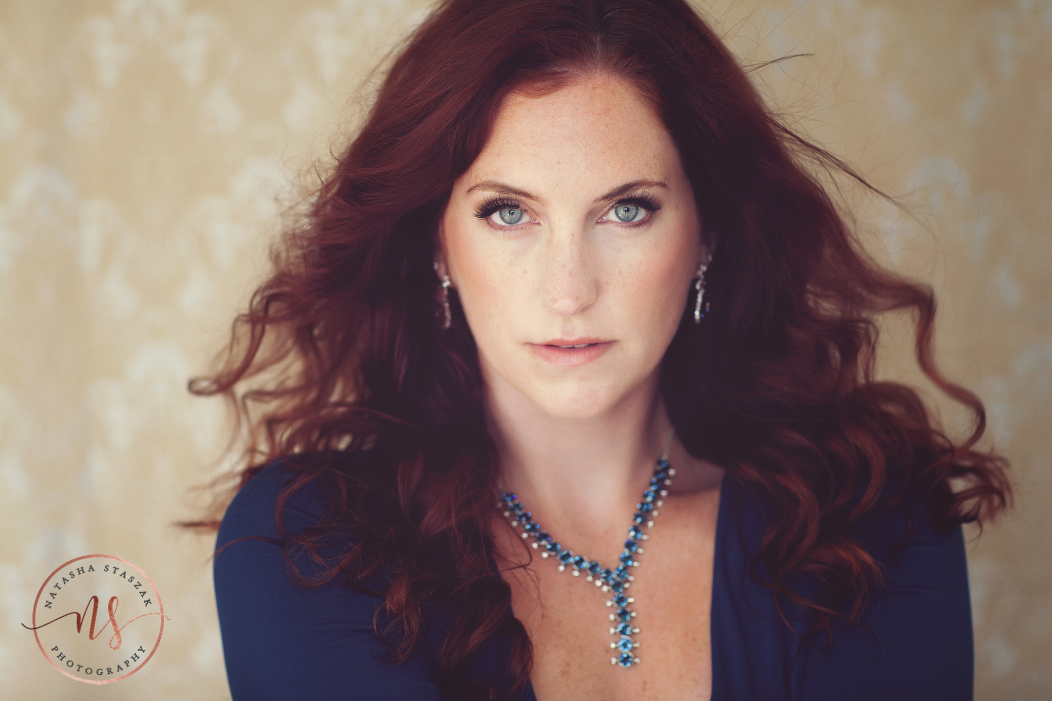 Gorgeous red head Cortney Chyme portrait with blue eyes and blue dress in Buffalo NY