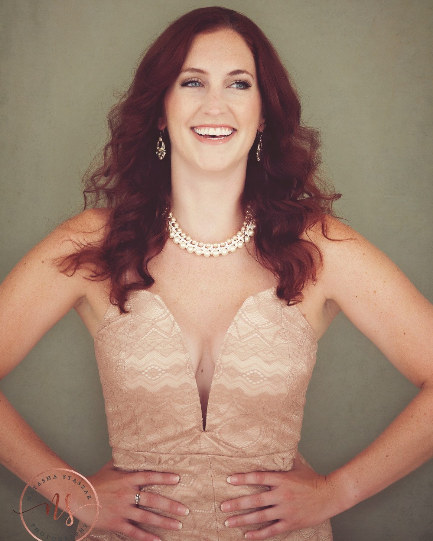 Portrait of Cortney Chyme with stunning red head, blue eyes, lace dress, laughing in Hamburg NY