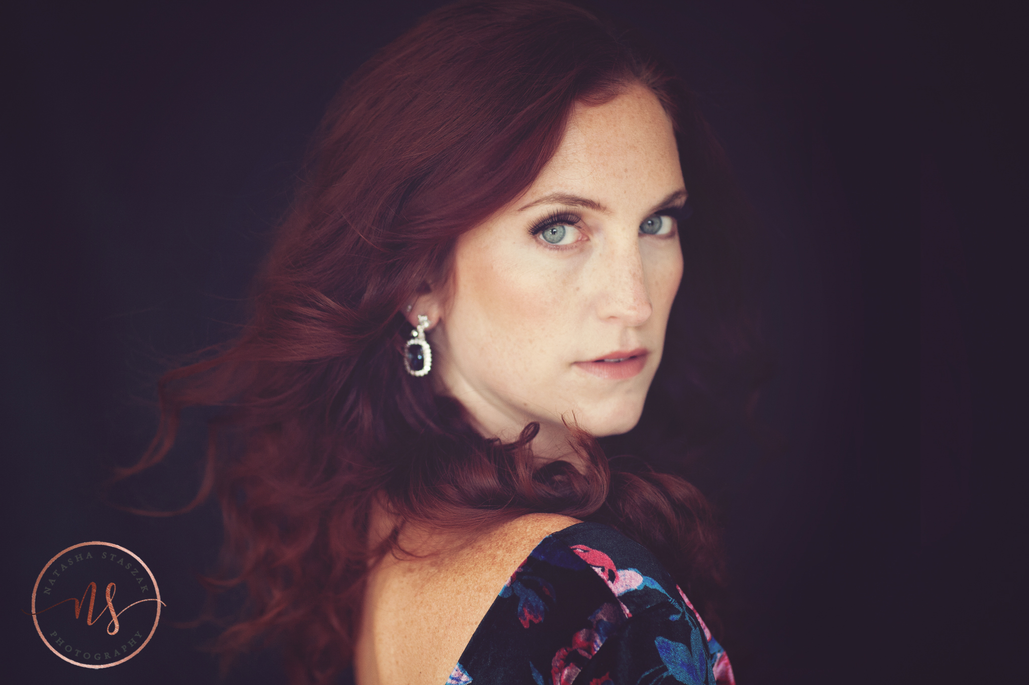 Amazing portrait close up of Cortney Chyme with red hair and blue eyes.