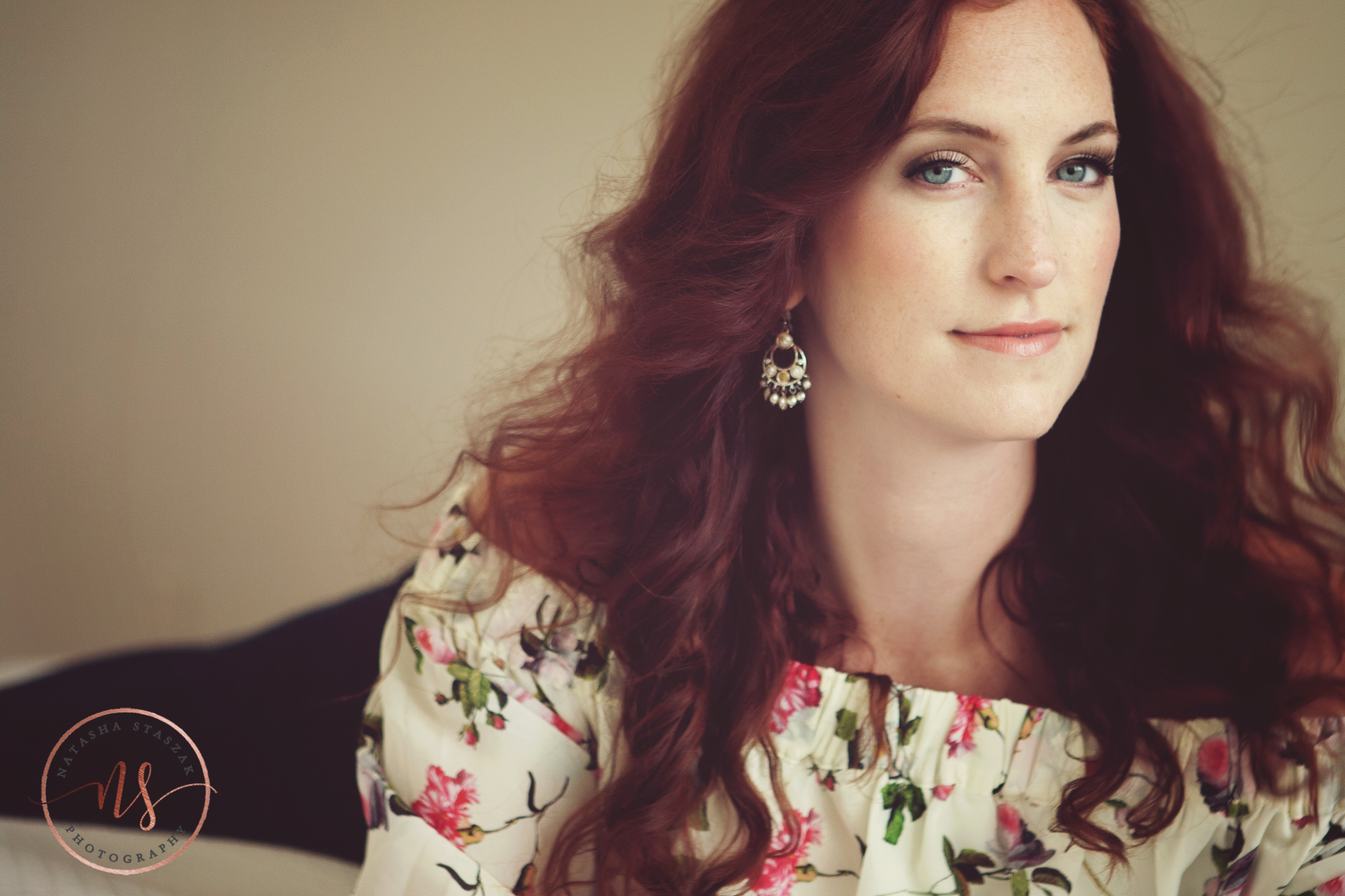 Beautiful portrait ofCortney Chyme with red hair and floral top in Buffalo NY