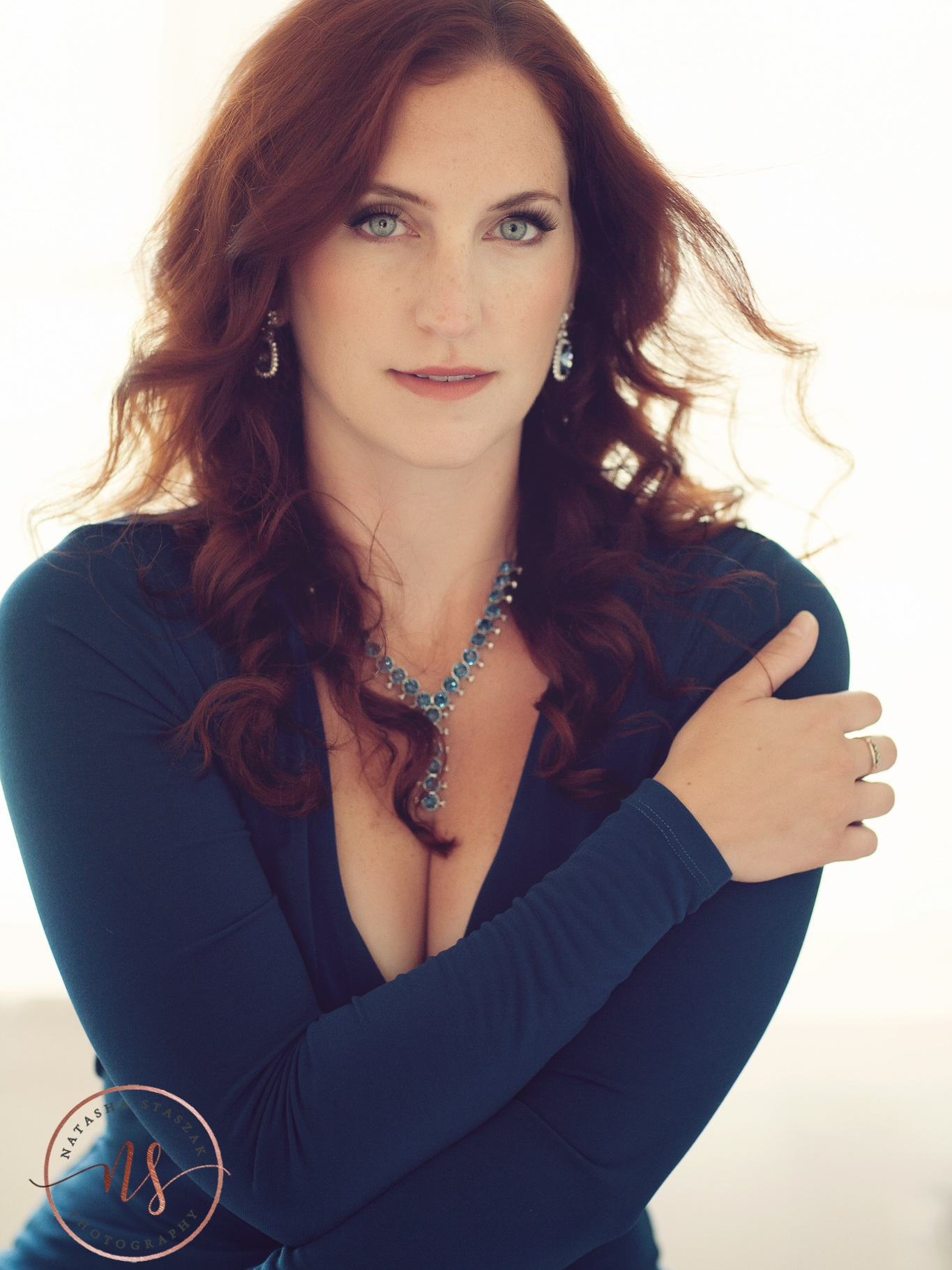 Portrait of Cortney Chyme in blue dress and red hair in Buffalo NY