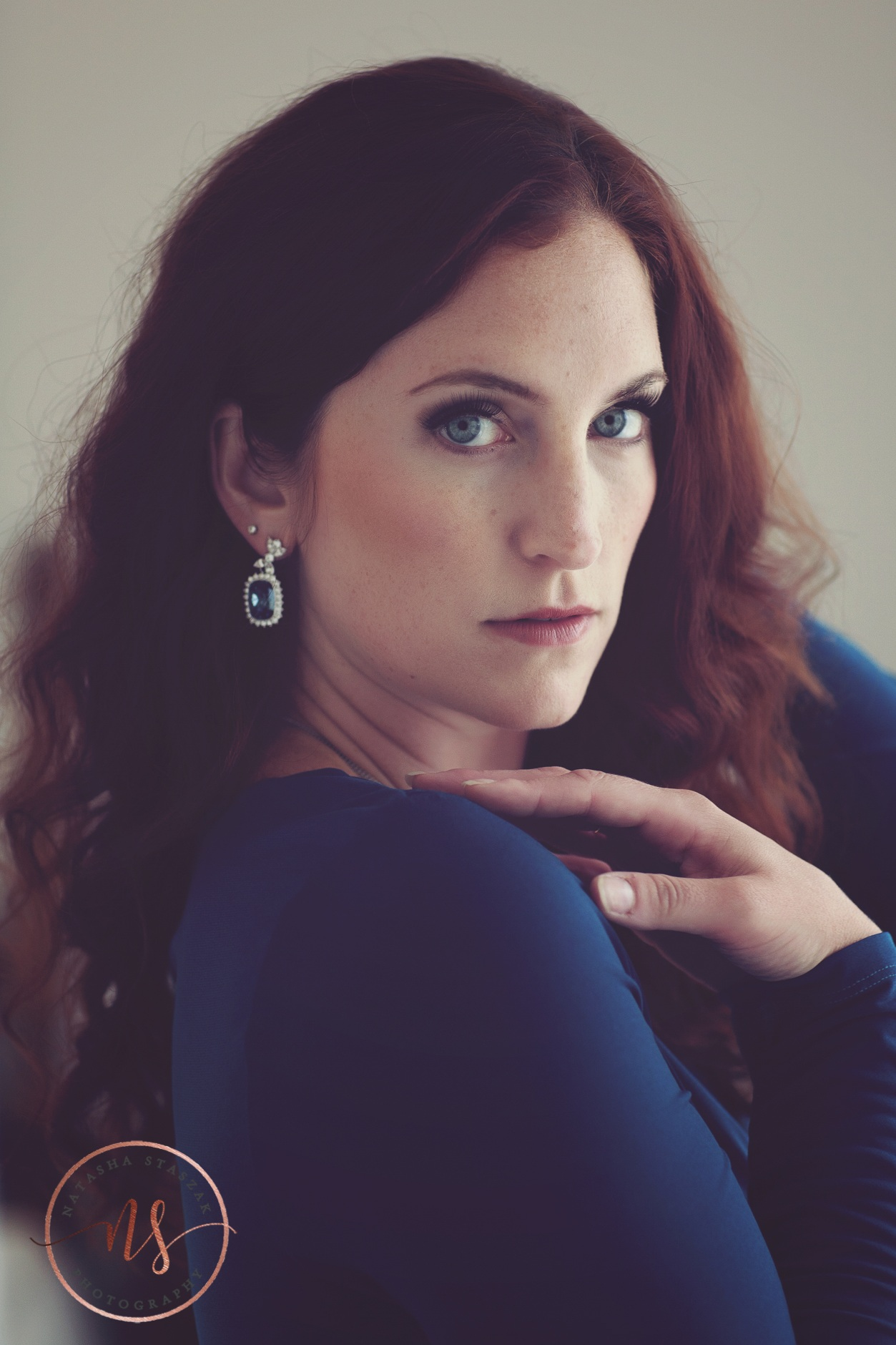 Beautiful Cortney Chyme portrait with blue dress and blue yes in Buffalo NY