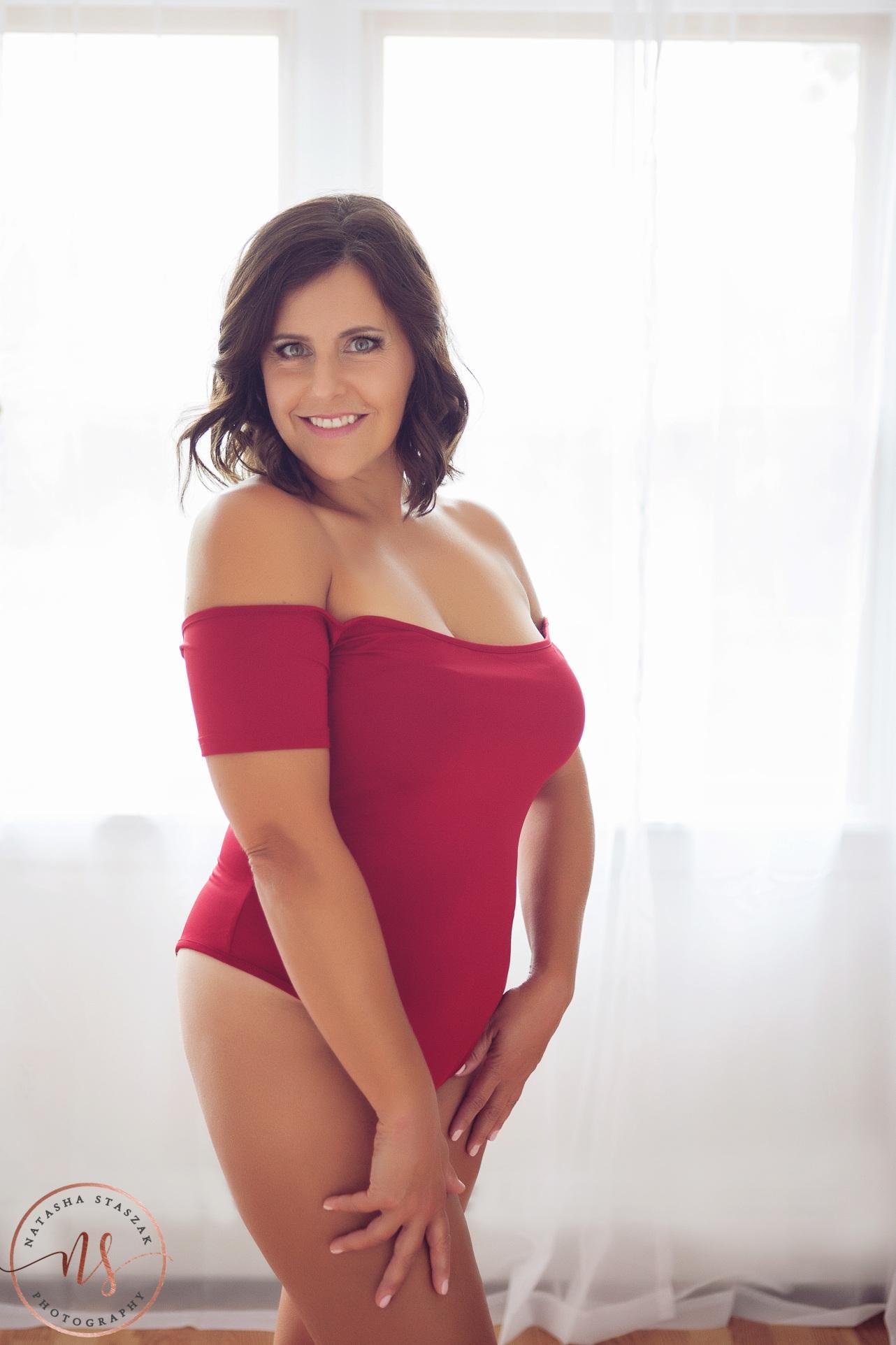 Boudoir Photographer Buffalo - Woman in red bodysuit