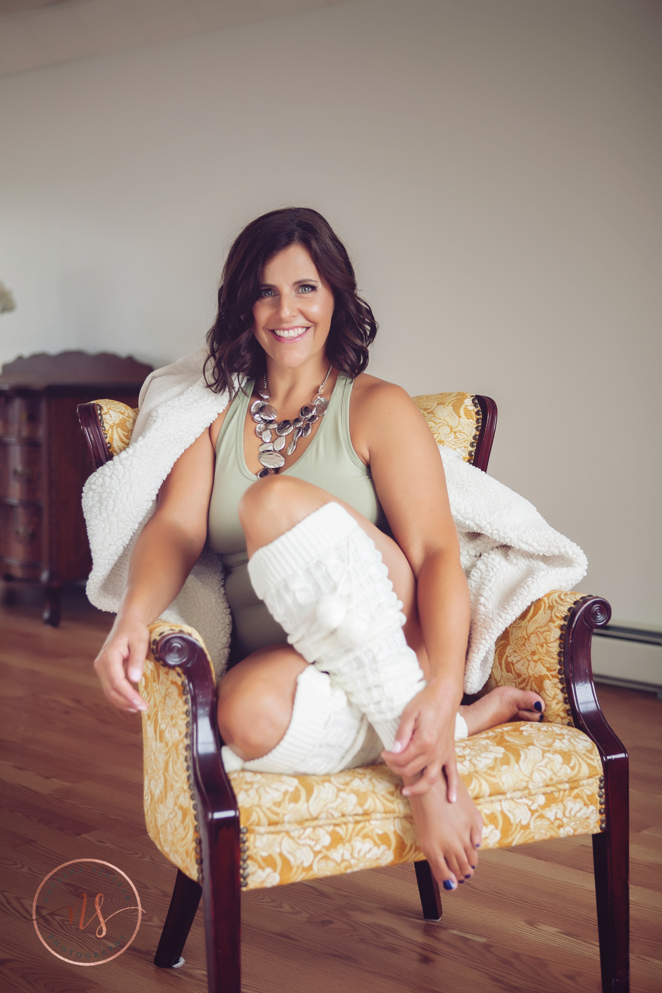 Buffalo Boudoir Photographer Natasha Staszak. Woman in chair boudoir shoot.