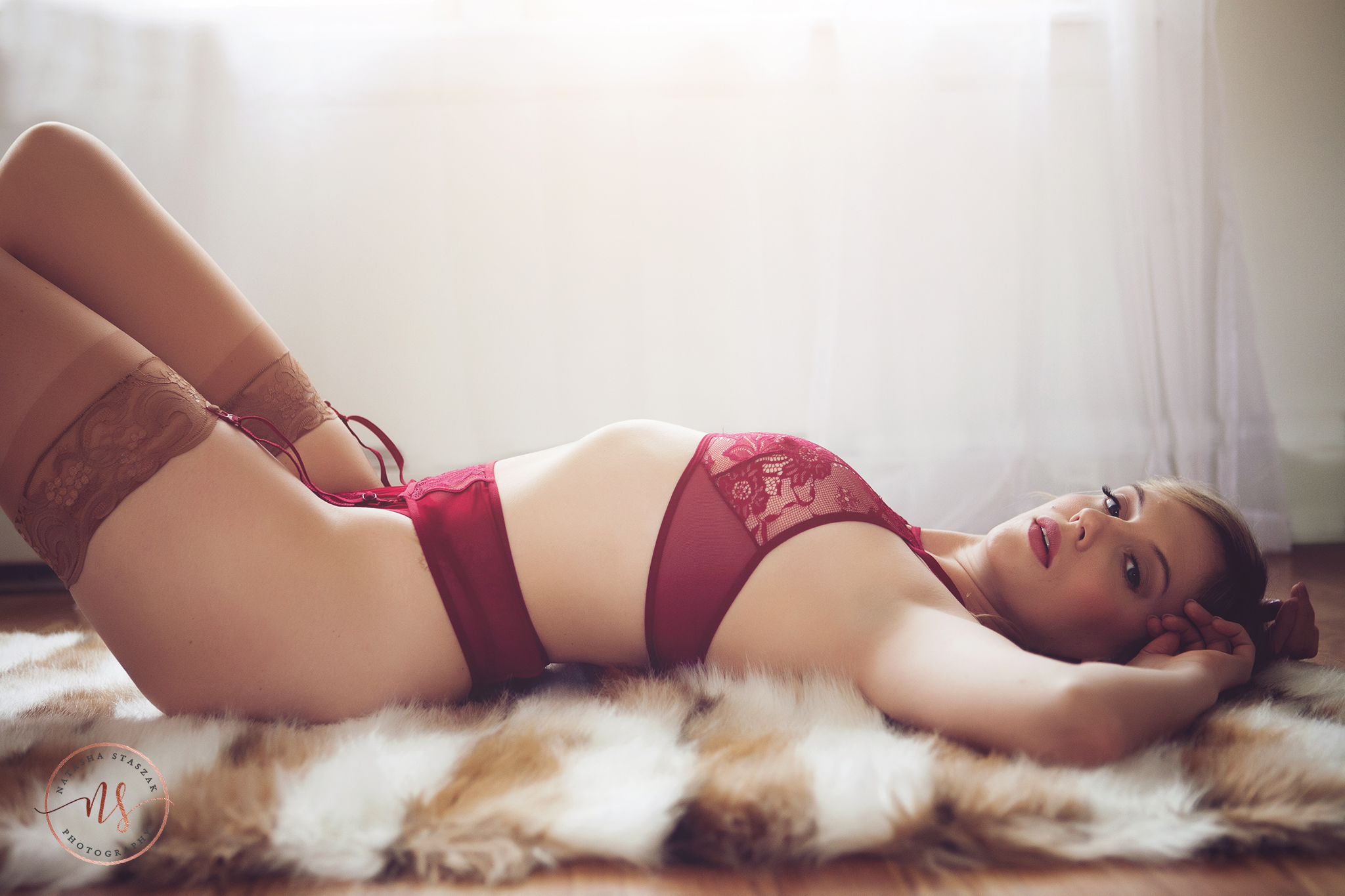 Red lingerie in Buffalo NY Boudoir photo shoot.