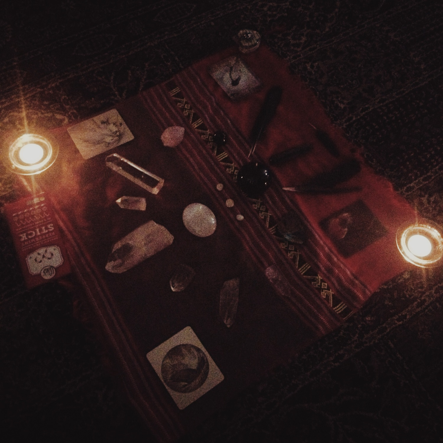 My 2013 Winter Solstice altar included crystals, Crow feathers, candles, and oracle cards. This altar represented the duality of both light, and darkness.