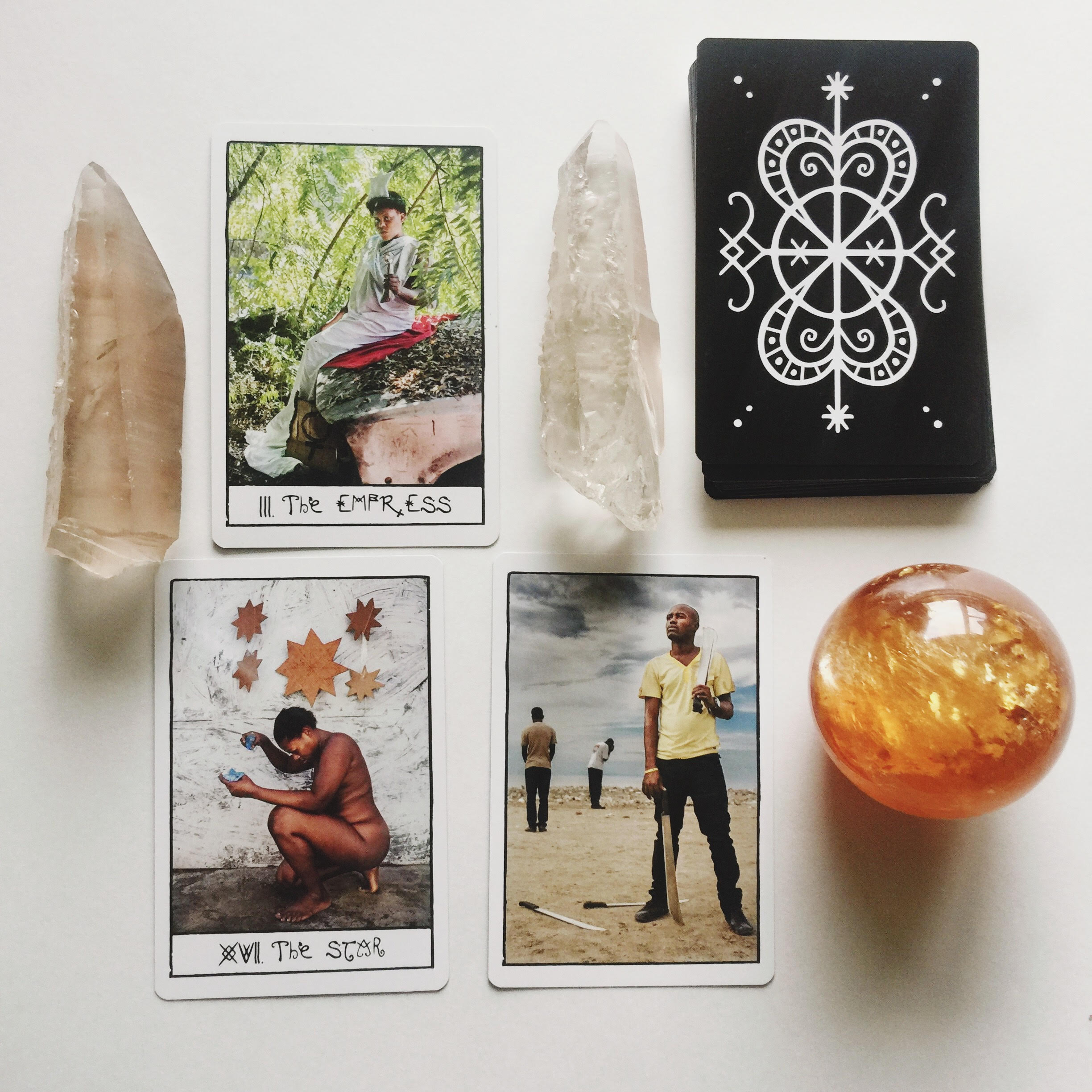 Photo by Bri Luna//The Haitian Tarot Deck featuring: The Empress, The Star, The 5 of Swords