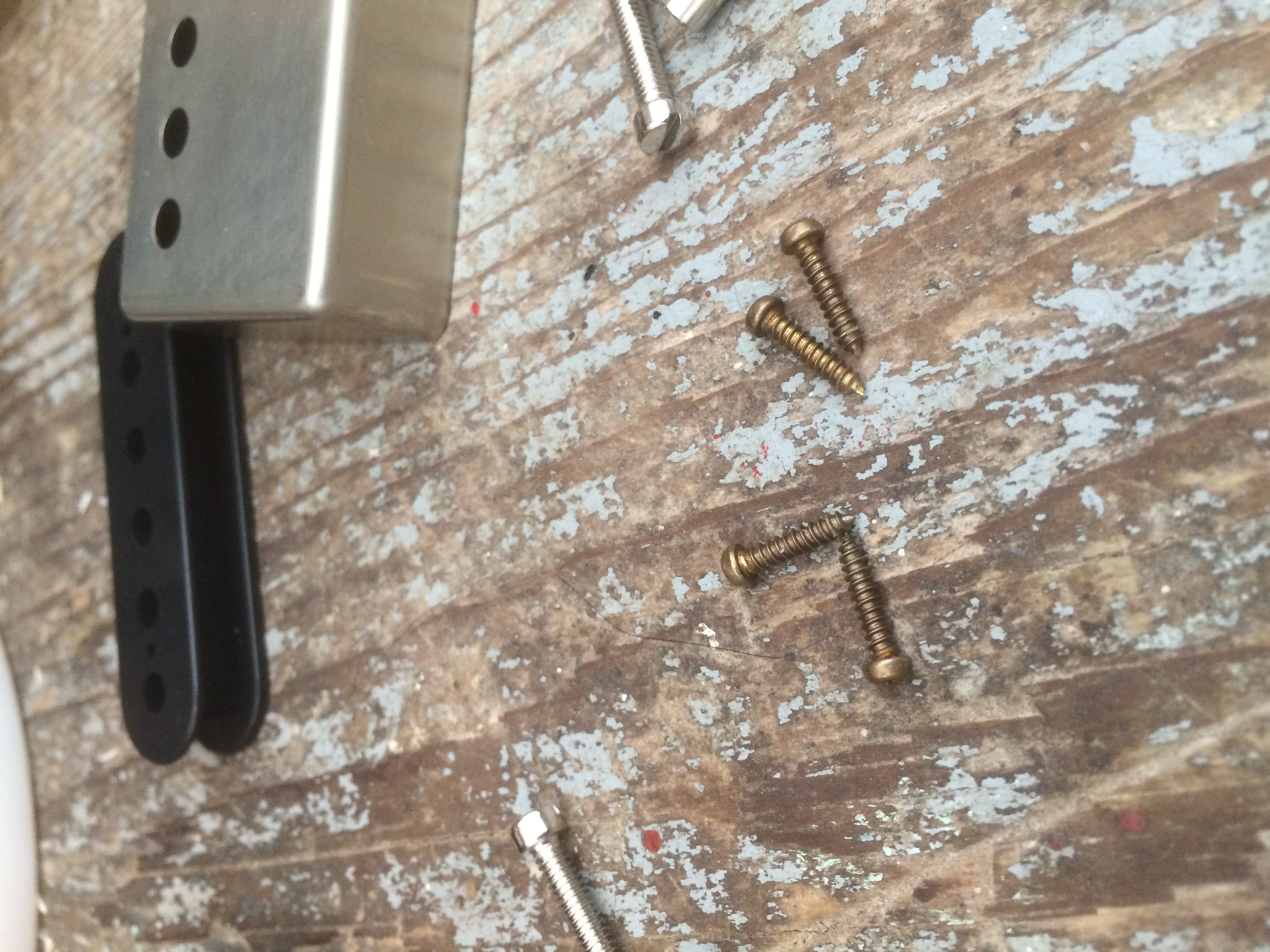 Brass screw attach the bobbins to the baseplate from the underside of the baseplate. The screws are in the magnetic field of the pickup, so the metallurgy can affect the tone.