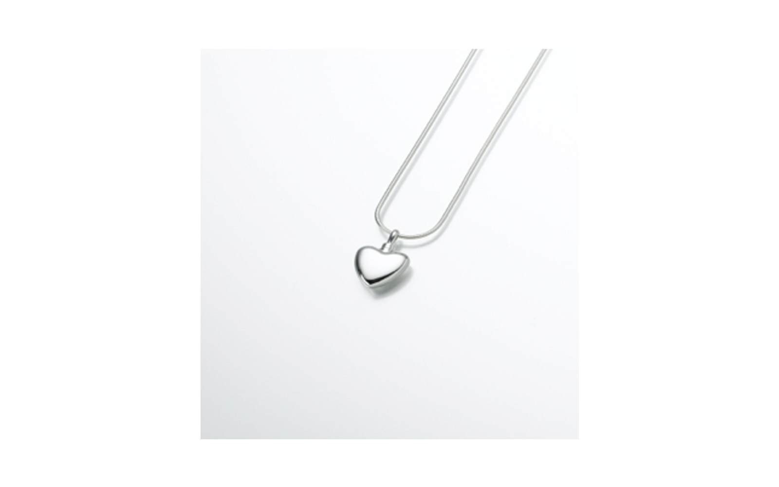 "Small Sterling Silver Heart Pendant     Measures   3/4""W x 3/4""H, Chain not included,  $150"