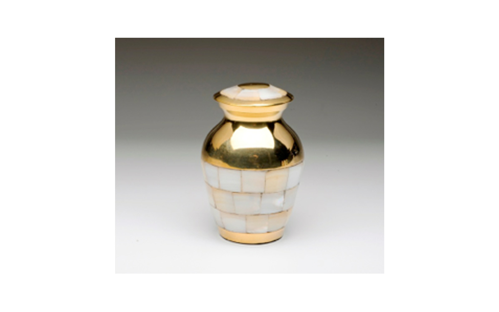 """Mother of Pearl Golden Brass Keepsake     This Golden Brass keepsake urn comes with a   Beautiful Mother of Pearl Inlay, Threaded Lid, Felt-Lined Base, and a Velvet Box.  Measures 3"""" H, 3 Cu. Inches, up to 2 lbs.,    $50"""