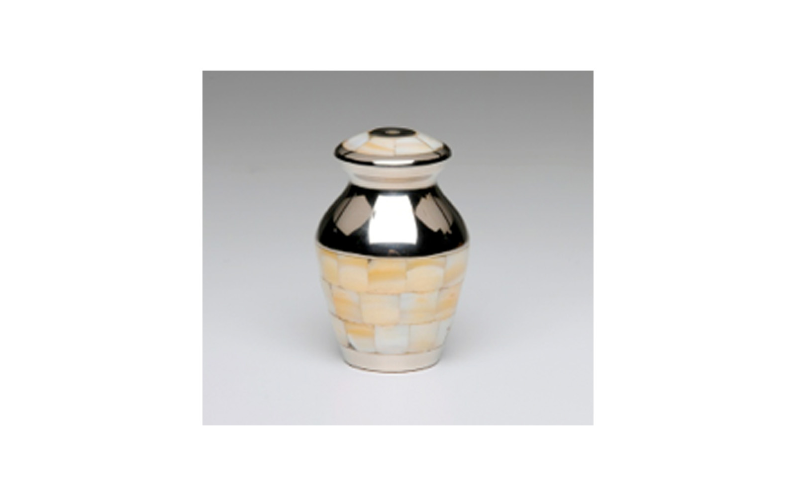 """Mother of Pearl Nickel Plated Brass Keepsake     This Nickel Plated Brass keepsake comes with a   Beautiful Mother of Pearl Inlay, Threaded Lid, Felt-Lined Base, and a Velvet Box.    Measures 3"""" H, 3 Cu. Inches, up to 2 lbs.,    $50"""