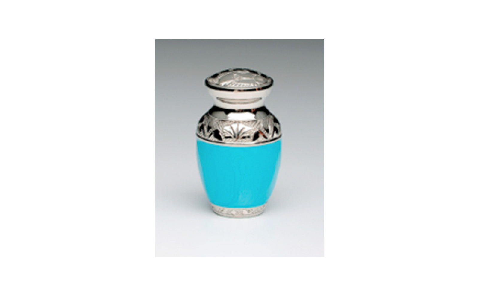 "Baby Blue & Baby Pink Keepsake   This keepsake comes in either   Baby Blue (shown) or Baby Pink Enamel over Nickel Plated Brass. It has a Threaded Lid, Felt-lined base, and comes with a Velvet Box. Measures 3"" H x 2"" W, 3 Cu. Inches, up to 2 lbs.,  $45"