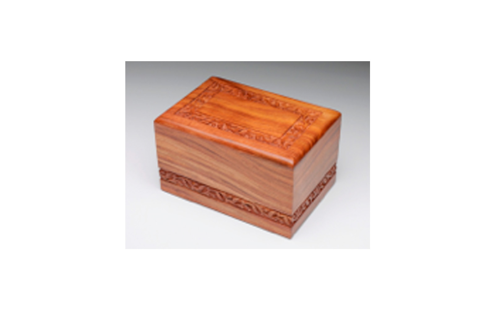 "Hand-Carved Rosewood Urn Boarder Design   This urn is hand-carved and made of solid rosewood. This urn has a slide out base.  Measures 9.5"" L x 6.5"" W x 5.5"" H, 220 Cu. Inches, up to 210 lbs.,  $155"