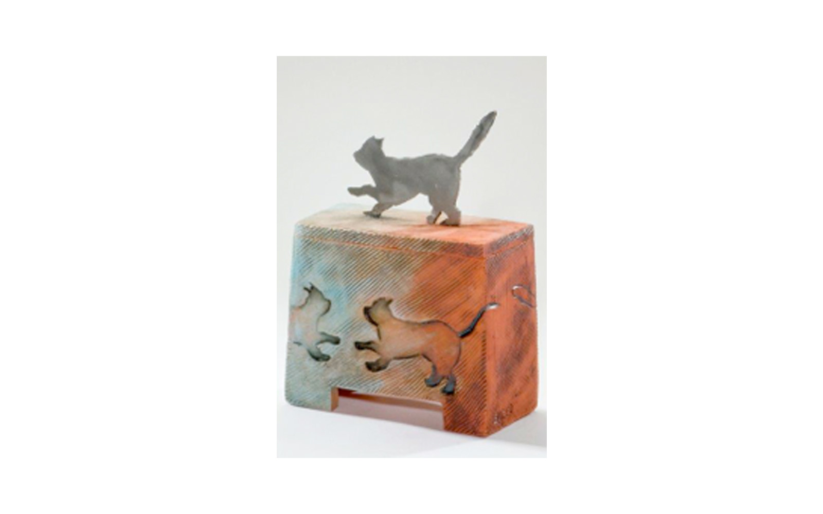 """Kool Kat Ceramic Pet Urn    This ceramic urn is Unique, Vibrant, and shows the Spunkiness of the cat. This urn has a Custom Metal Cat Cut Handle used to Imprint the sides of the urn. This urn measures 5 ¾"""" L x 2 ¾"""" W x 8 ¼"""" H, 35 Cu. Inches, up to 35 lbs. $365    *Please Note: Each piece is uniquely made by its Artist resulting in different colors and weight"""
