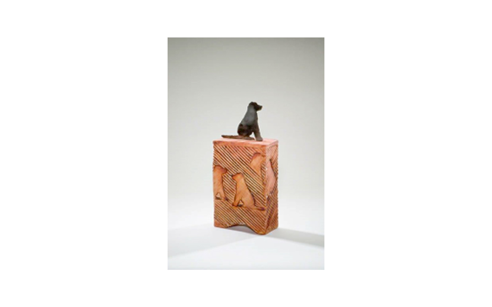 """Stay Ceramic Dog Cremation Urn    This ceramic urn is Unique, Vibrant, and Displays the Obedience and Loyalty of the Dog. This urn has a Custom Metal Dog Cut Handle used to imprint the sides of the urn. This urn measures 5 ½"""" L x 2 ½"""" W x 12"""" H, 60 Cu. Inches, up to 60 lbs. $390    *Please Note: Each piece is uniquely made by its Artist resulting in different colors and weight"""