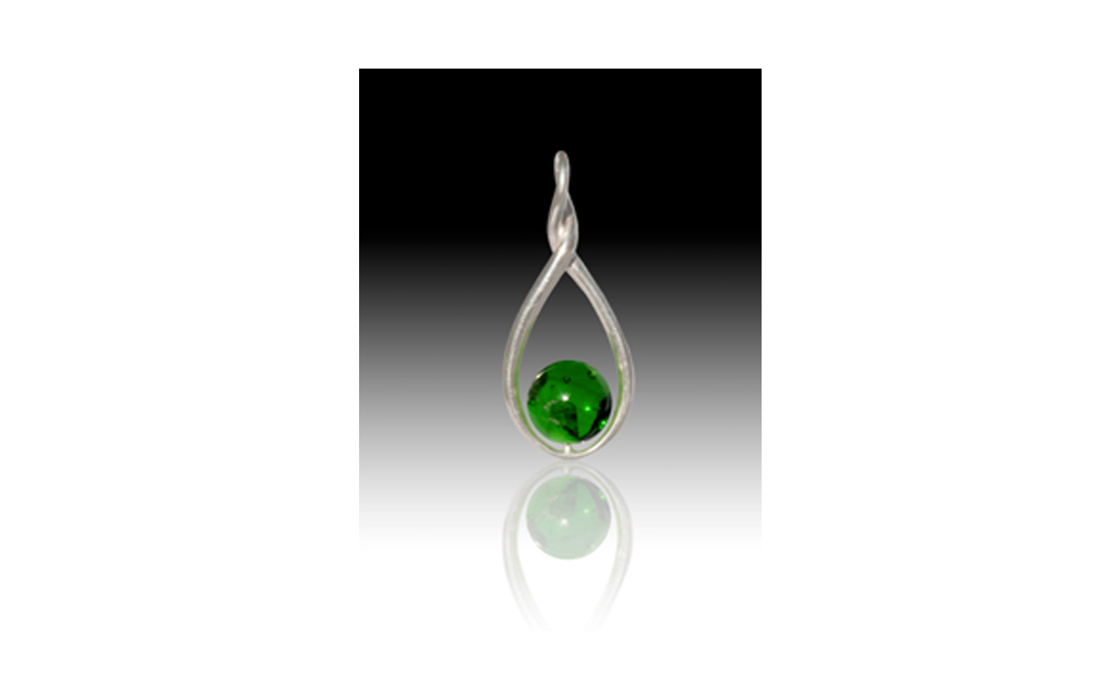 Melody Twist Pendant   This Solid Sterling Silver pendant has a touch of elegance by combining Sterling Silver and a 9mm glass pearl containing your loved one's cremated remains. This pendant's bail opening measures 3.1mm and its dimensions are 33 x 14mm. This keepsake comes in Red, Orange, Yellow, Green, Blue, Purple, Lavender, Pink, Gray, Black, and Turquoise   $195