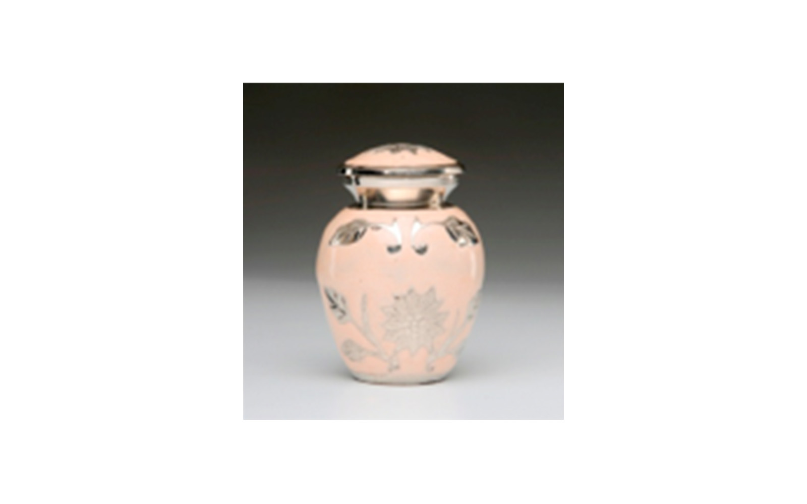 "Flowered Peach Colored Keepsake      This elegant urn is made of a Peach Colored Enamel over Nickel Plated Brass. It has a Hand-Tooled Flower Design, Threaded Lid, a Felt-Lined Base, and comes in a Velvet Box.   Measures 3"" x 2.25"" H, 3 Cu. Inches, up to 2 lbs.,    $55"