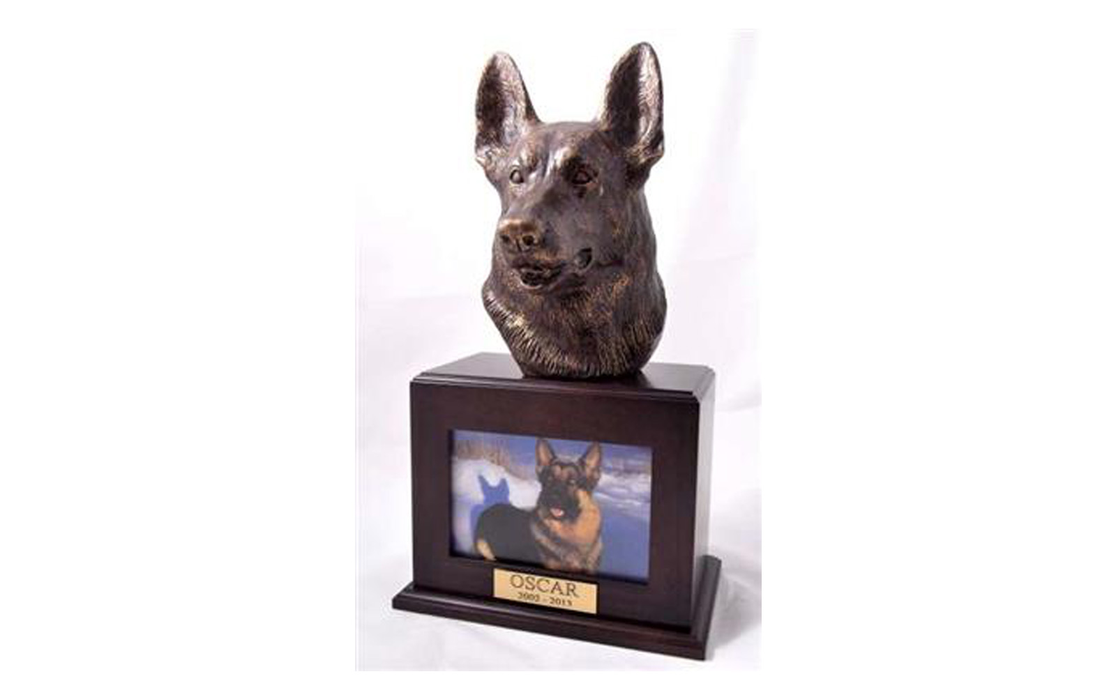 """German Shepherd Picture Urn Walnut   This photo urn features a sculpted German Shepherd set on genuine Walnut wood urn. The sculpture is made of polymer with a bronze additive.  Measures 9"""" W x 6"""" D x 16"""" H and holds 110 cubic inches, up to 110 lbs. The sculpture measures 6"""" W x 8"""" D x 9"""" H.,   $265  with name plate     $240  without name plate"""