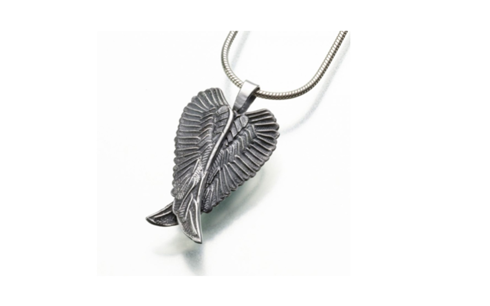 "Angel Wings Urn Pendant   This pendant measures 3/16""W x 1-3/16""H and comes in both sterling silver or gold vermeil. Has a threaded opening in the back to fill with ashes or hair of your beloved pet.  Sterling Silver:  $215   Gold Vermeil:  $225"