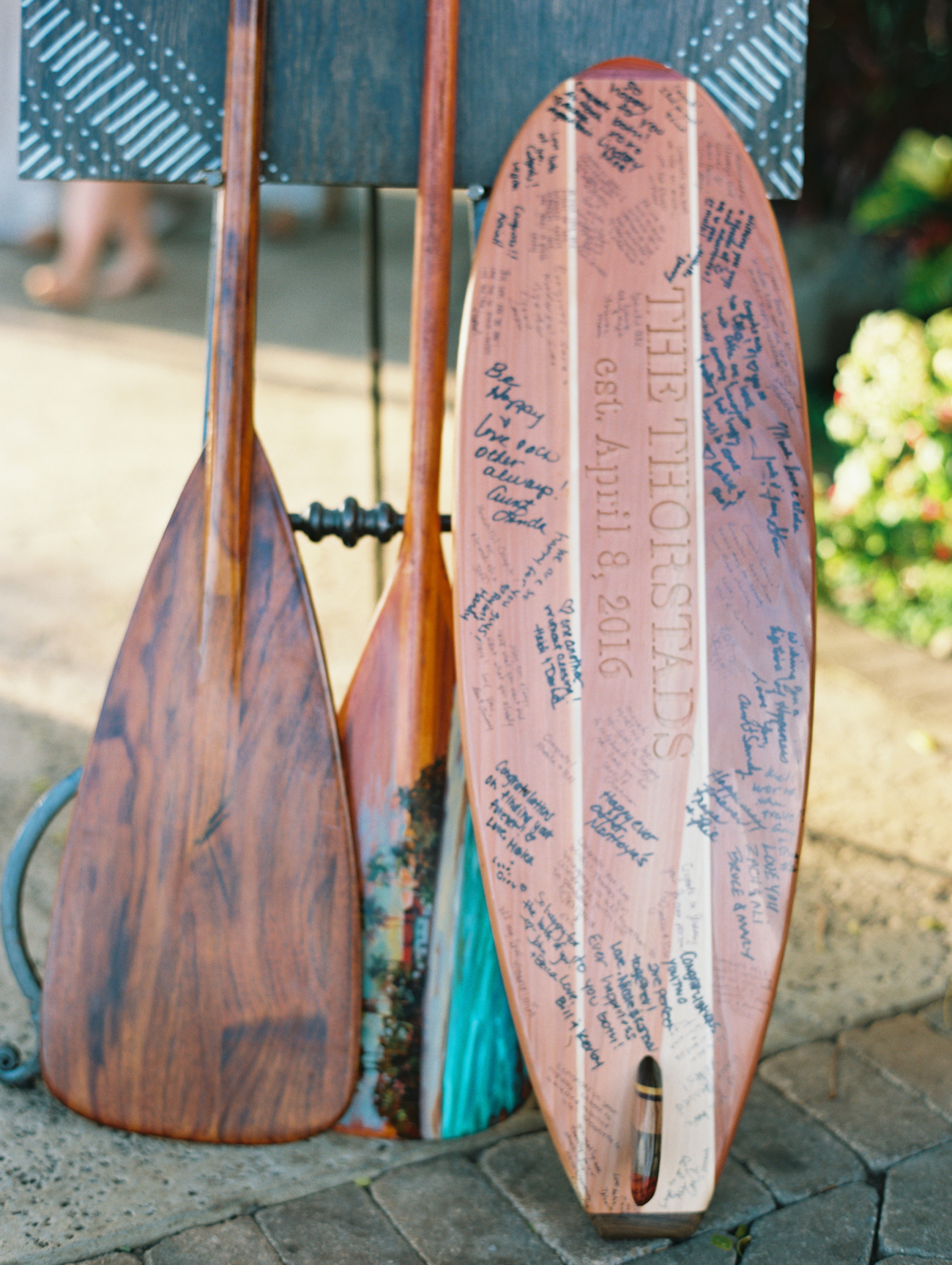 custom engraved surfboard guestbook; as featured in The Knot winter 2016 issue