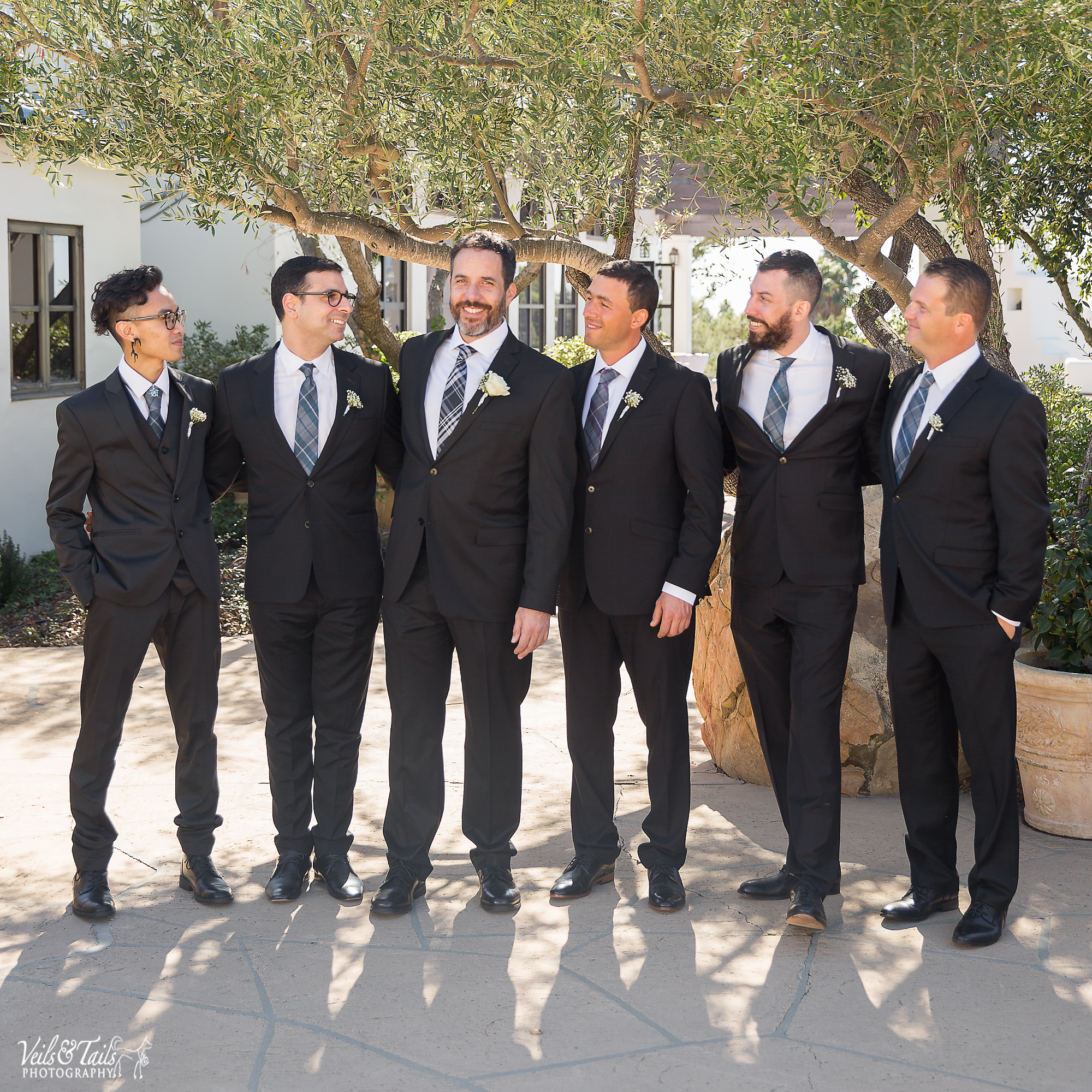 groomsmen with purple ties