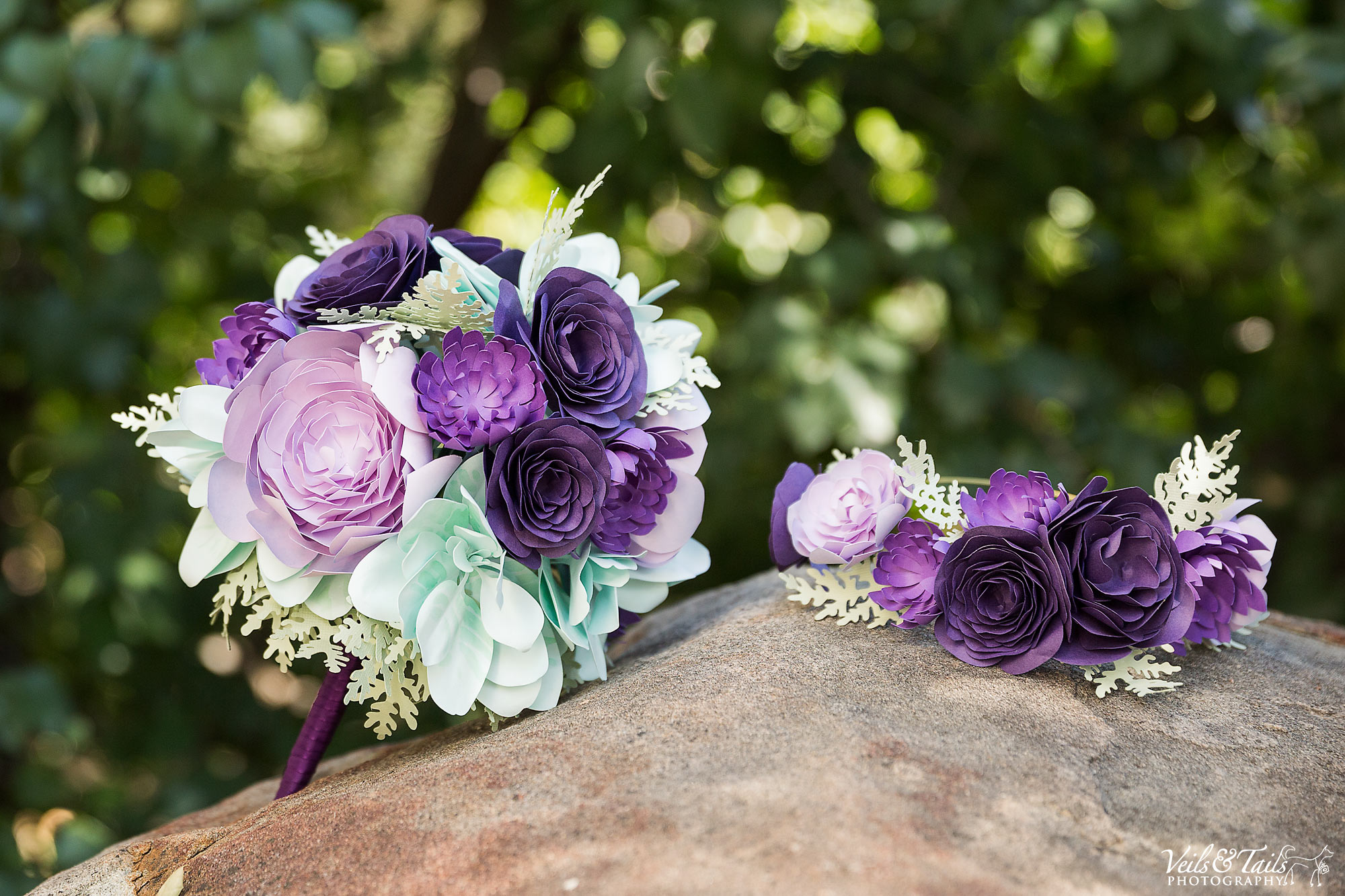 wedding florals with purples and light green