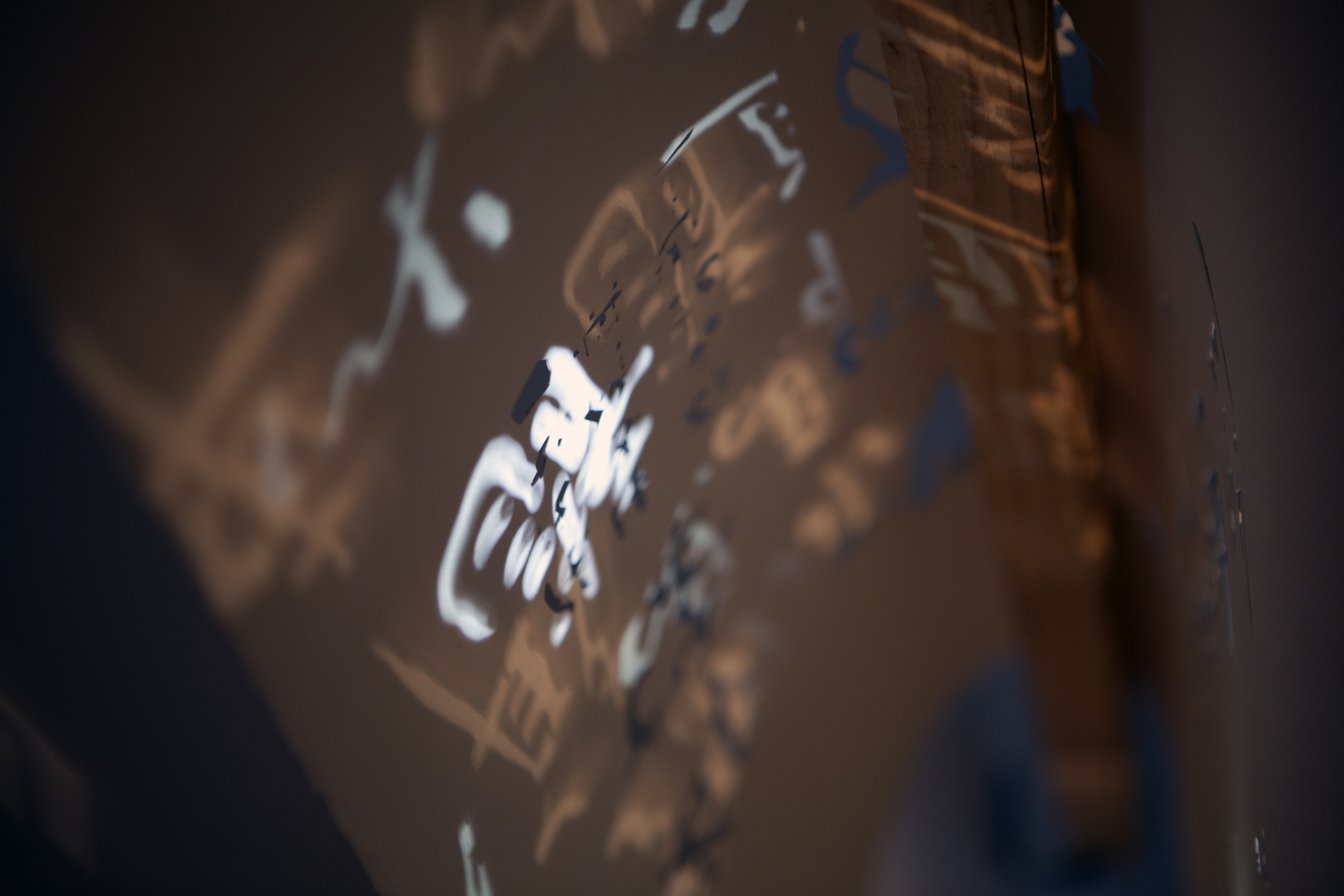 Calligraphy Cutout (Detail)    Hand cut paper, wooden armature, LED and incandescent light  2013
