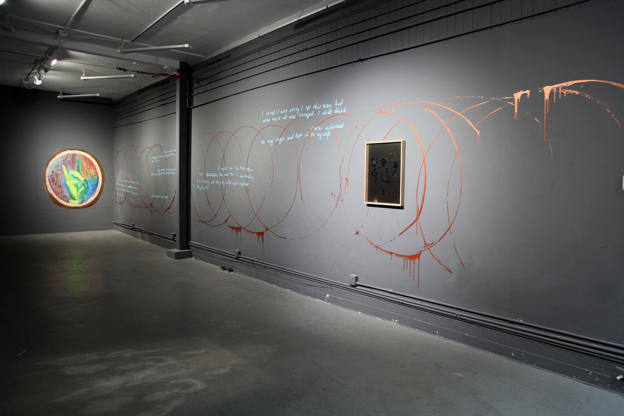 Installation of smoke print titled Anarchists and Pacifists in gallery with mural with copper paint and painting, copper, copper paint, pastel, smoke and mirror., 2017