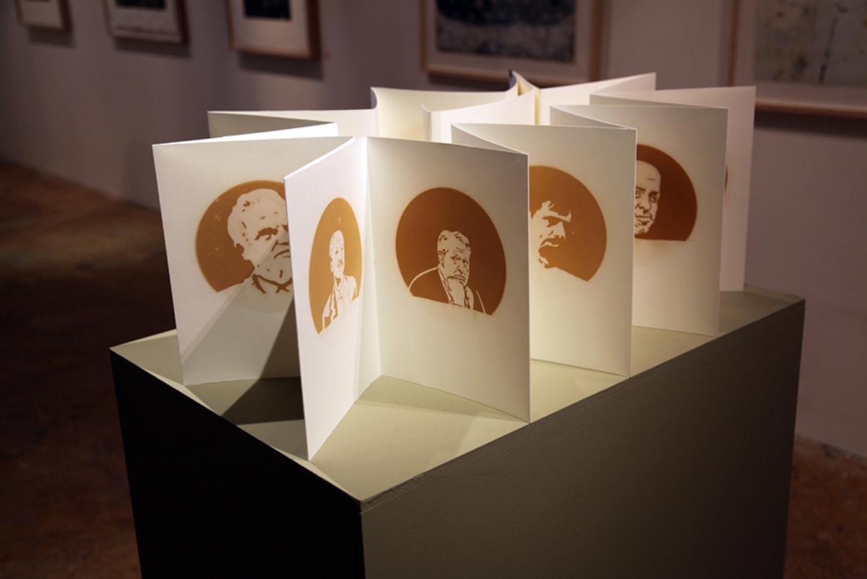 $ick Men , incense smoke oil on paper, 2013. Accordion fold book depicting various white collar financial criminals.