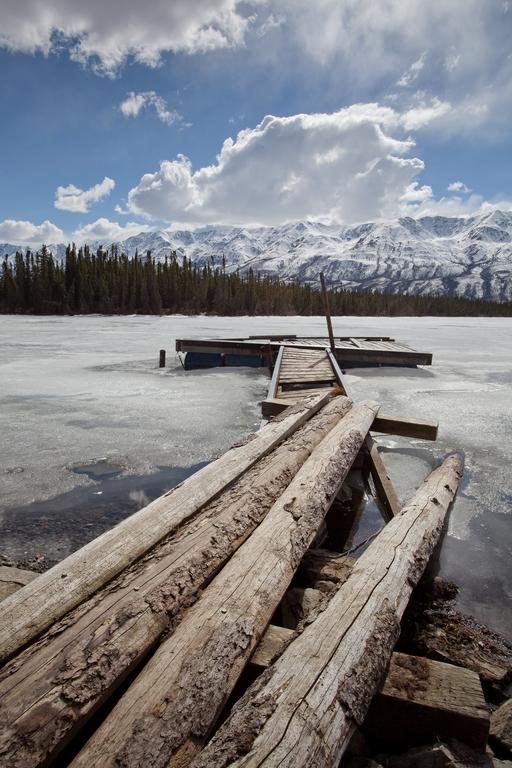 Wooden Jetty on Frozen Lake