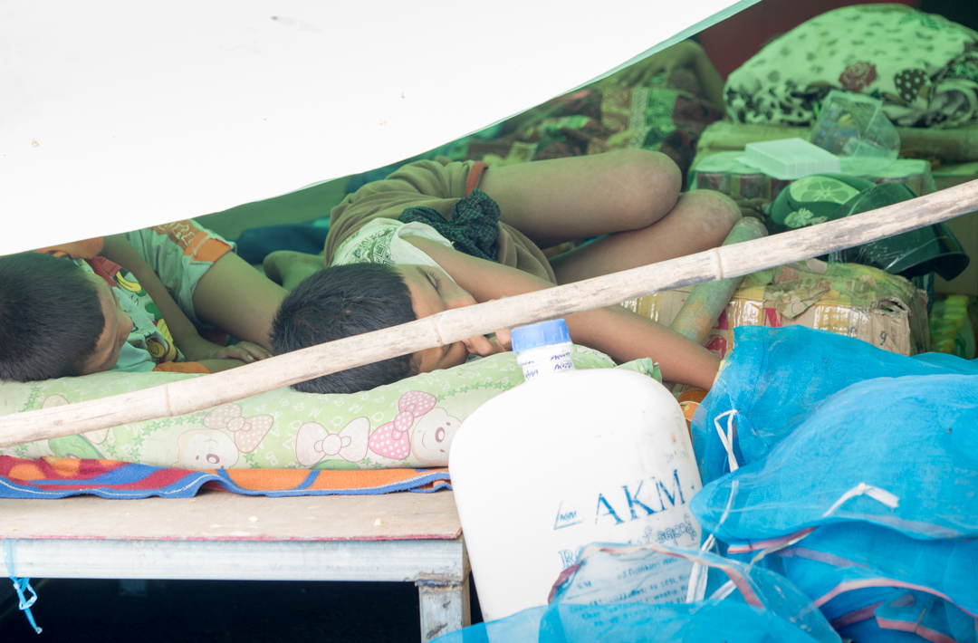 Family sleeping under plastic and tarpaulin at the side of the road..... Very tough indeed.....