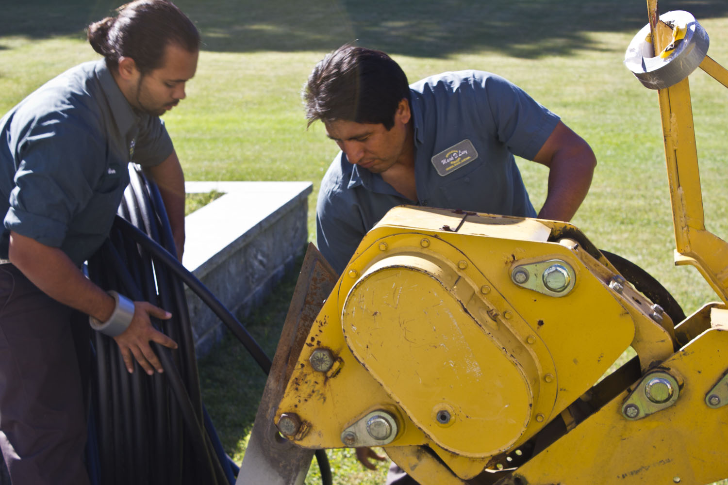 guys setting up irrigation trench machine.jpg