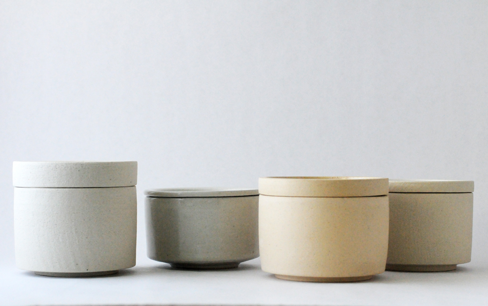 Various lid variations, and older, straight sided piece second from the right.