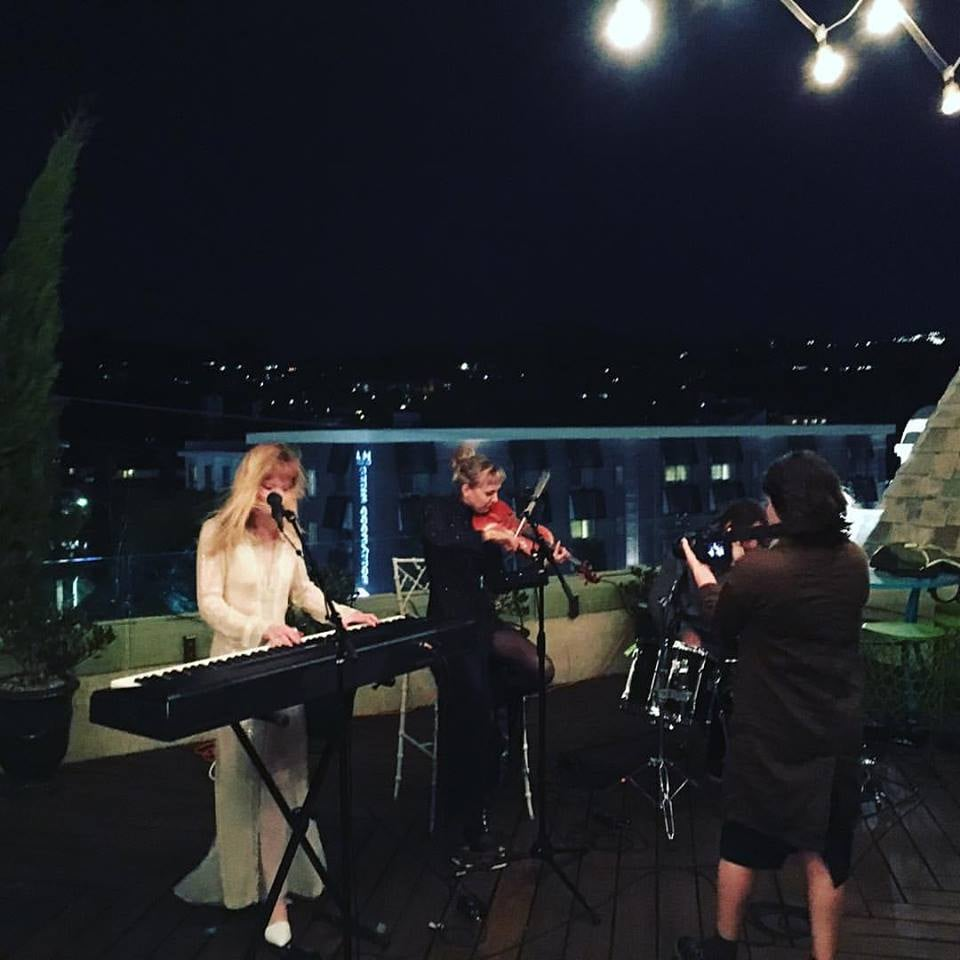 Taping a windy Balcony TV live session atop The Hollywood Towers
