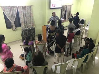Edgar leading prayer for Regions Beyond churches around the world