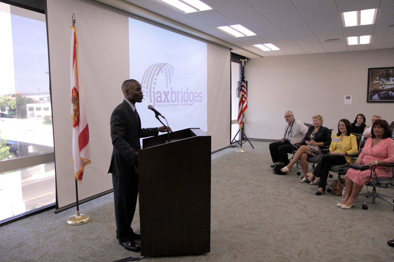 Carlton Robinson, JAX Chamber Senior Director of Entrepreneurial Development, announces JAX Bridges to business leaders and the media.