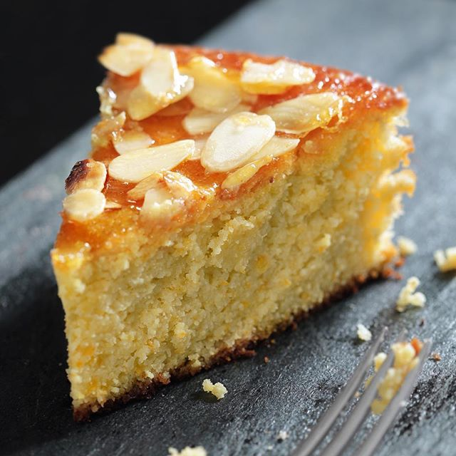 Our gluten-free orange polenta cake 😍 And if you're in Fitzrovia this week, pop in and get a slice and hot drink for £3.50 👍🏻 Available in our Charlotte Place bakery until Friday 😀