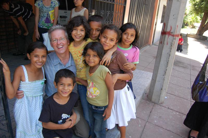 Dr. Vanderpool surrounded by children (Photo from Livebeyond.org website)