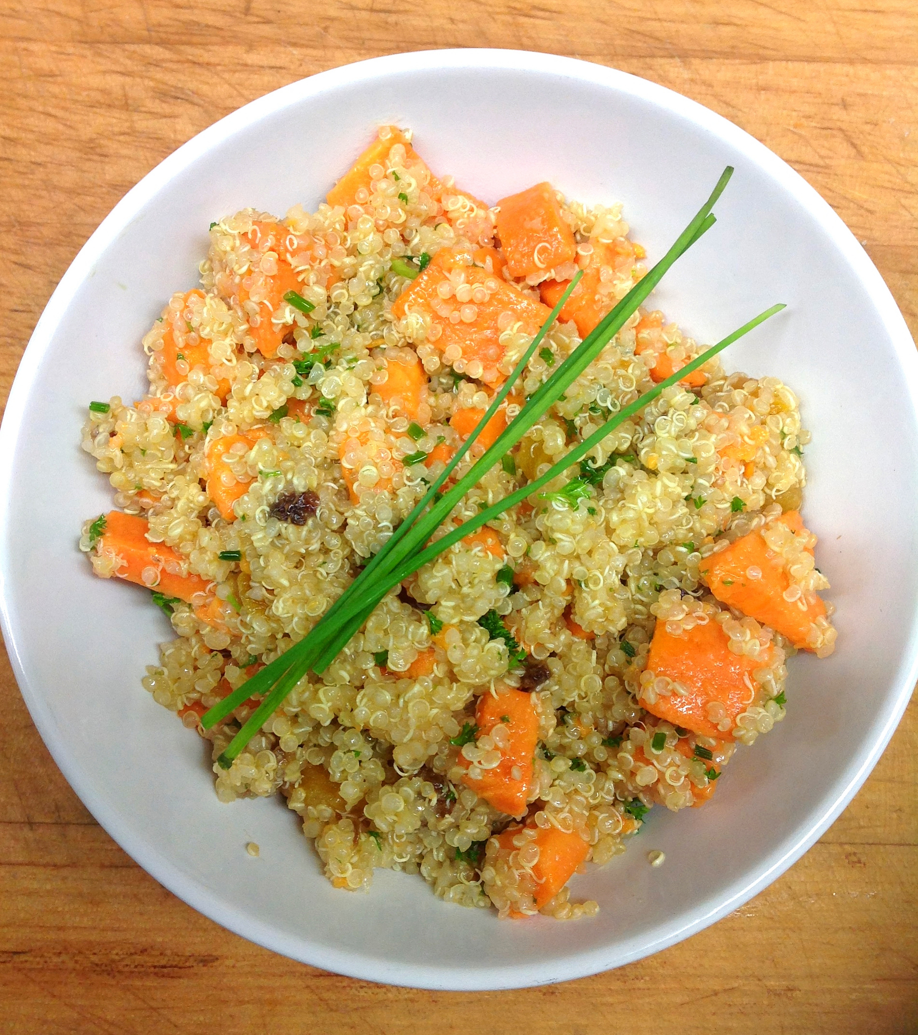 Quinoa with yams, dried apricots, dates and chives in a Meyers lemon vinagrette