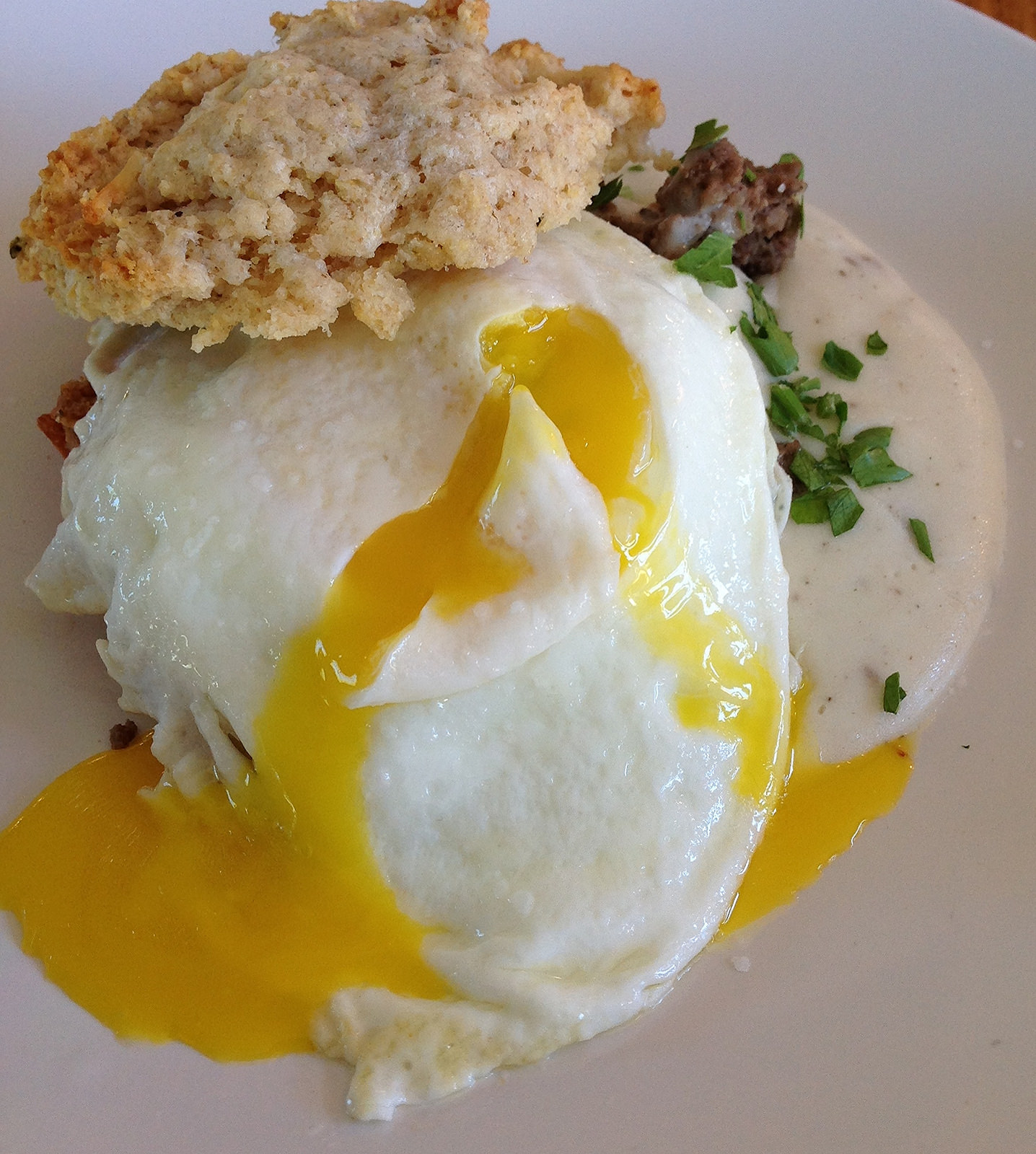 Savory scone, with country gravy and a runny egg