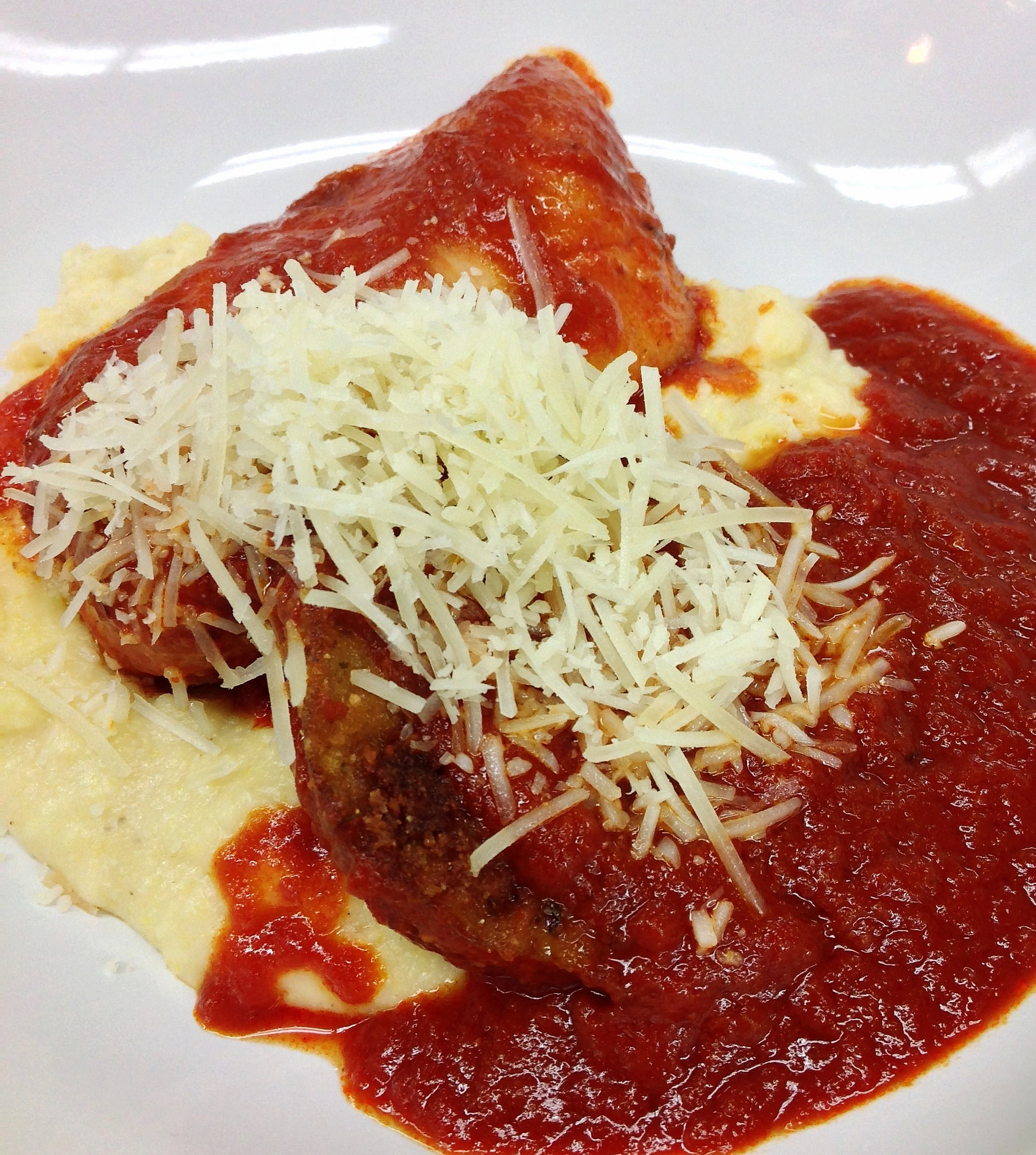 Chicken and eggplant parmigiano over polenta