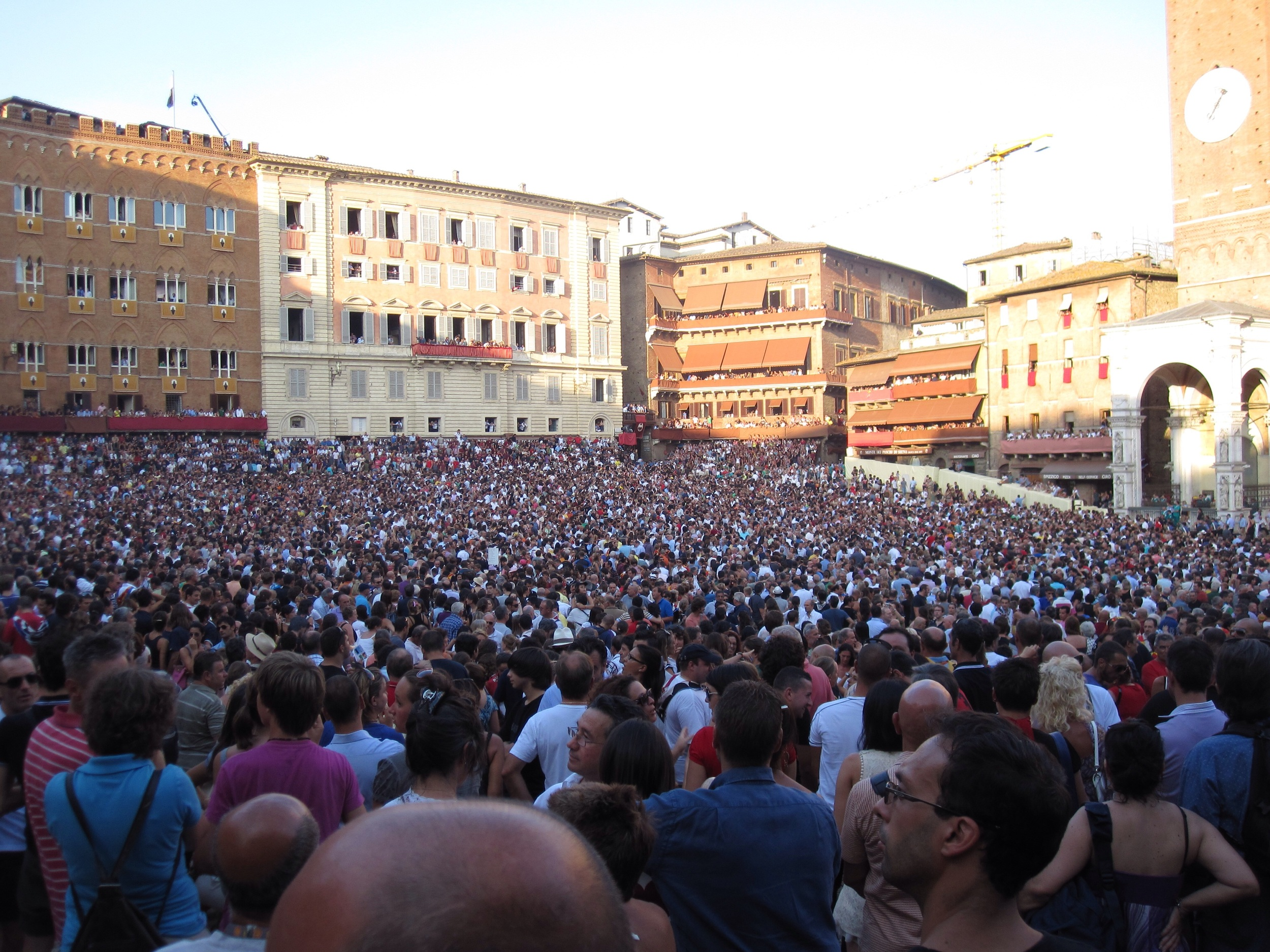Il Campo for the 2009 Palio in Siena, my shaved head in the foreground.