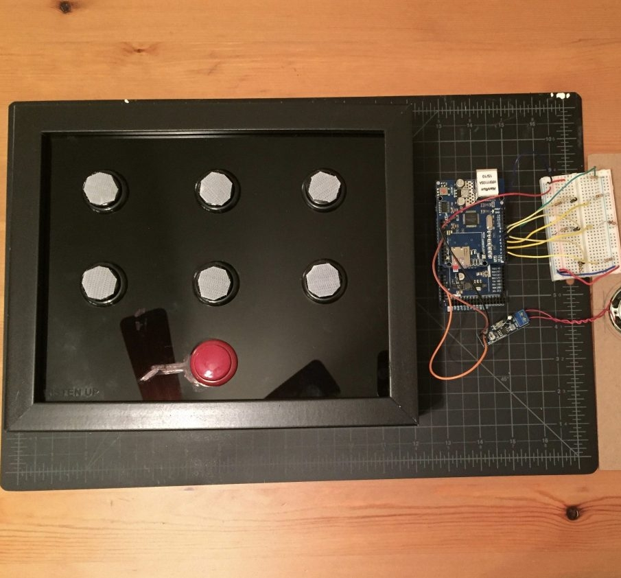 Second prototype comprised of acrylic, arcade buttons, fitted inside a shadowbox frame.