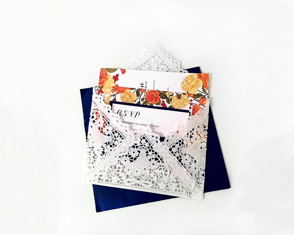 Invitation nested inside lace envelope
