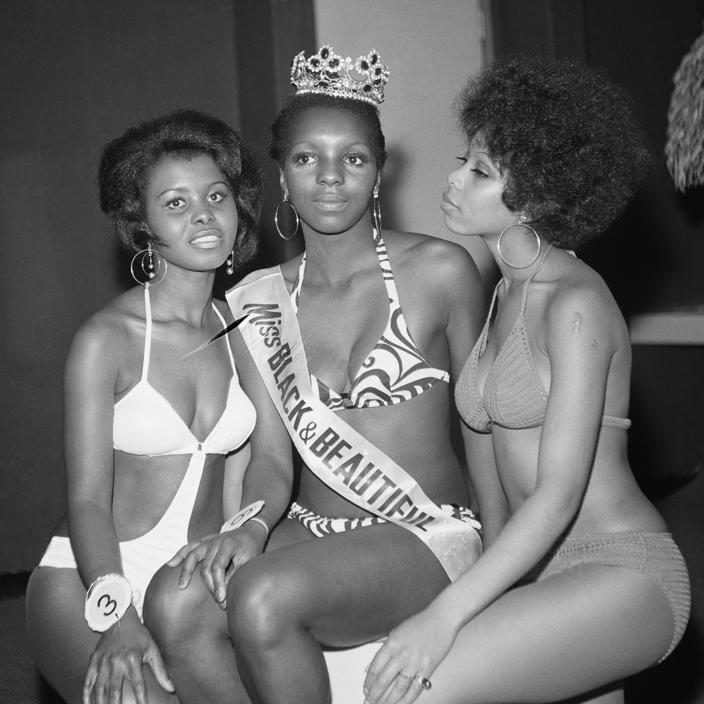 (Unidentified) Miss Black & Beautiful with fellow contestants ,London, Hammersmith Palais, 1970s.From the portfolio 'Black Beauty Pageants'.Courtesy of © Raphael Albert/Autograph ABP