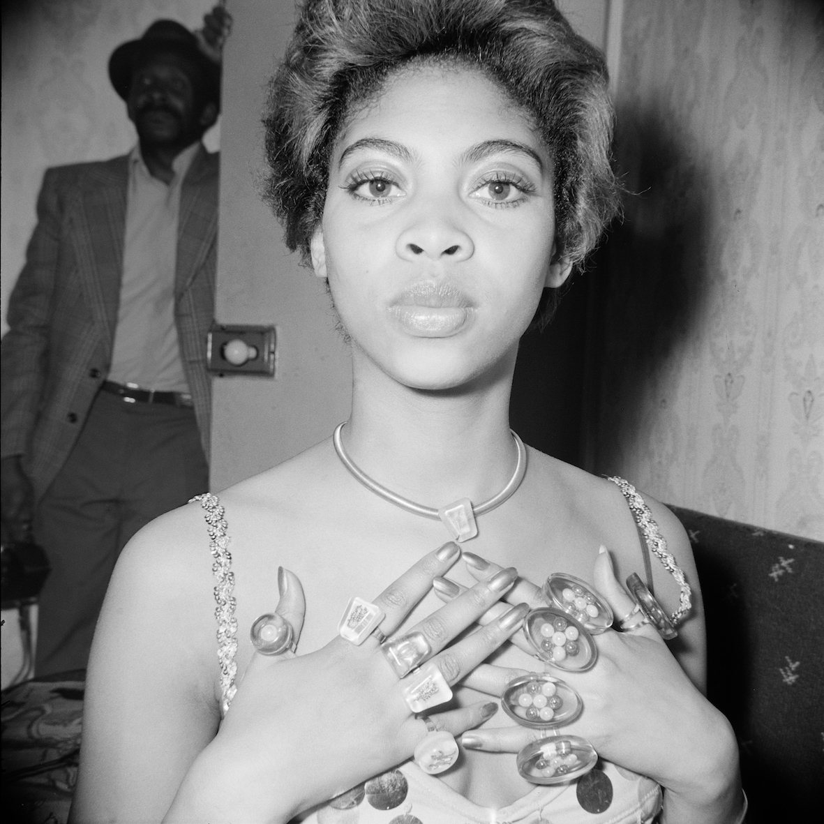 Holley modelling jewellery at Blythe Road,  Hammersmith,London,early 1970s.From the portfolio 'Black Beauty Pageants'.Courtesy of © Raphael Albert/Autograph ABP